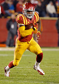 Running back Mike Warren of the Iowa State Cyclones rushes for yards in the second half of play against the Texas Longhorns at Jack Trice Stadium on...