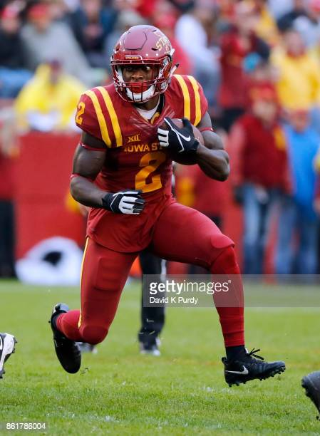 Running back Mike Warren of the Iowa State Cyclones rushes for yards in the second half of play against the Kansas Jayhawks at Jack Trice Stadium on...