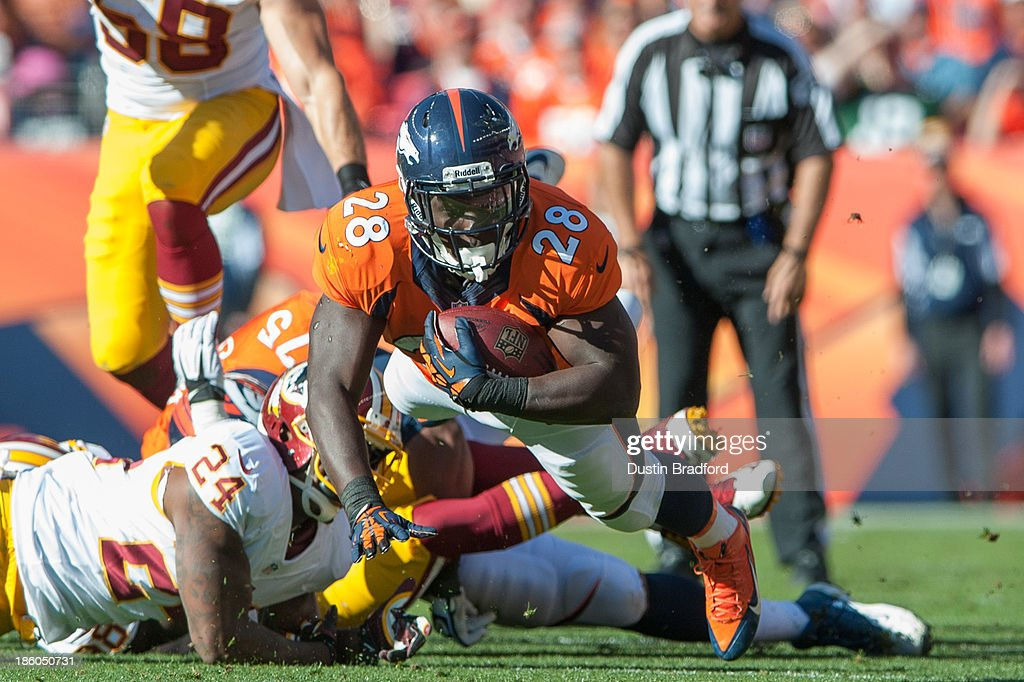 Running back <a gi-track='captionPersonalityLinkClicked' href=/galleries/search?phrase=Montee+Ball&family=editorial&specificpeople=6475135 ng-click='$event.stopPropagation()'>Montee Ball</a> #28 of the Denver Broncos dives for extra yards against the Washington Redskins during a game at Sports Authority Field Field at Mile High on October 27, 2013 in Denver, Colorado.