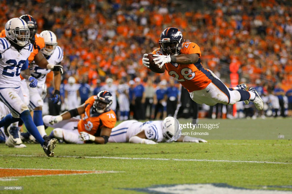 Running back <a gi-track='captionPersonalityLinkClicked' href=/galleries/search?phrase=Montee+Ball&family=editorial&specificpeople=6475135 ng-click='$event.stopPropagation()'>Montee Ball</a> #28 of the Denver Broncos dives into the end zone for a fourth quarter rushing touchdown against the Indianapolis Colts at Sports Authority Field at Mile High on September 7, 2014 in Denver, Colorado.