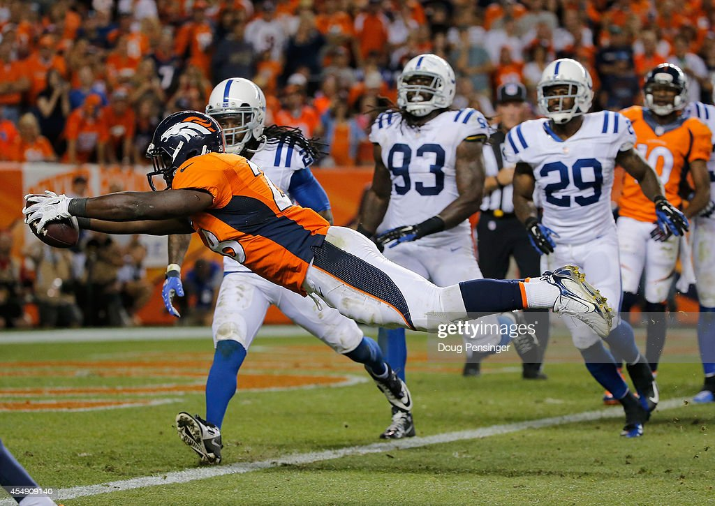 Running back Montee Ball #28 of the Denver Broncos dives into the endzone for a three yard touchdown against the Indianapolis Colts to take a 31-10 lead in the fourth quarter at Sports Authority Field at Mile High on September 7, 2014 in Denver, Colorado.