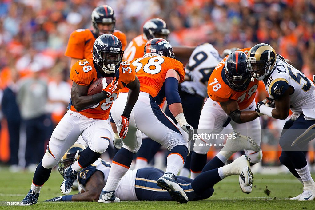 Running back <a gi-track='captionPersonalityLinkClicked' href=/galleries/search?phrase=Montee+Ball&family=editorial&specificpeople=6475135 ng-click='$event.stopPropagation()'>Montee Ball</a> #38 of the Denver Broncos in action against the St. Louis Rams at Sports Authority Field at Mile High on August 24, 2013 in Denver, Colorado.