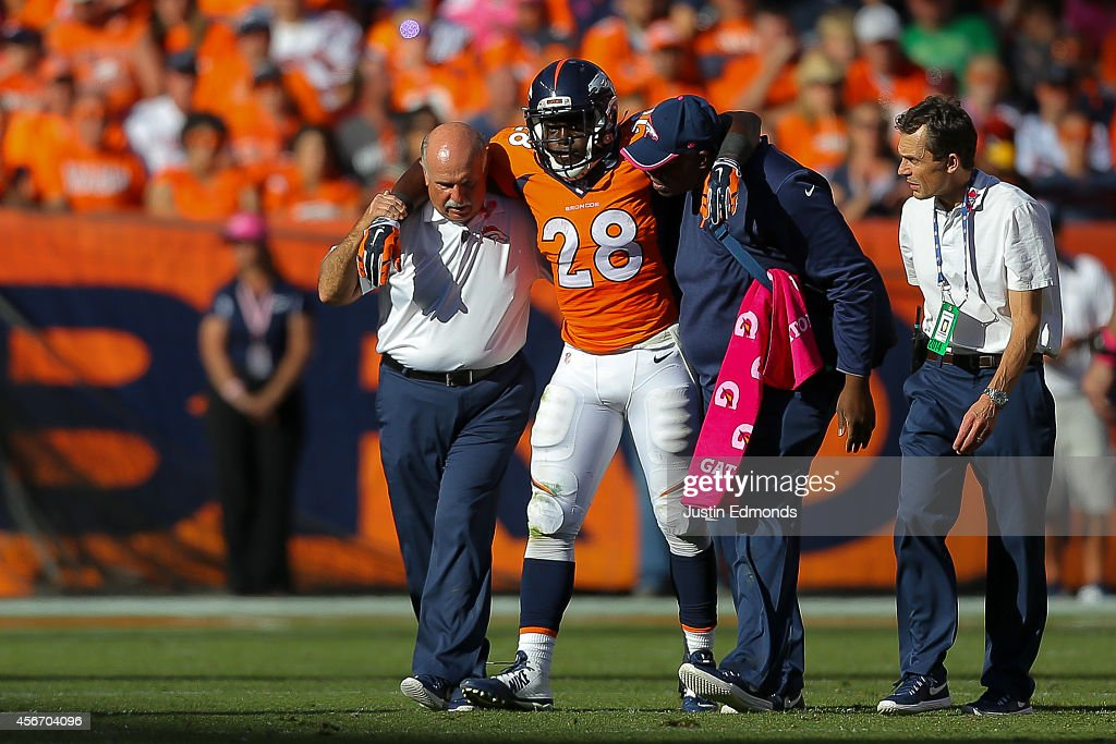 Running back <a gi-track='captionPersonalityLinkClicked' href=/galleries/search?phrase=Montee+Ball&family=editorial&specificpeople=6475135 ng-click='$event.stopPropagation()'>Montee Ball</a> #28 of the Denver Broncos is helped off the field after an injury during a game against the Arizona Cardinals at Sports Authority Field at Mile High on October 5, 2014 in Denver, Colorado.