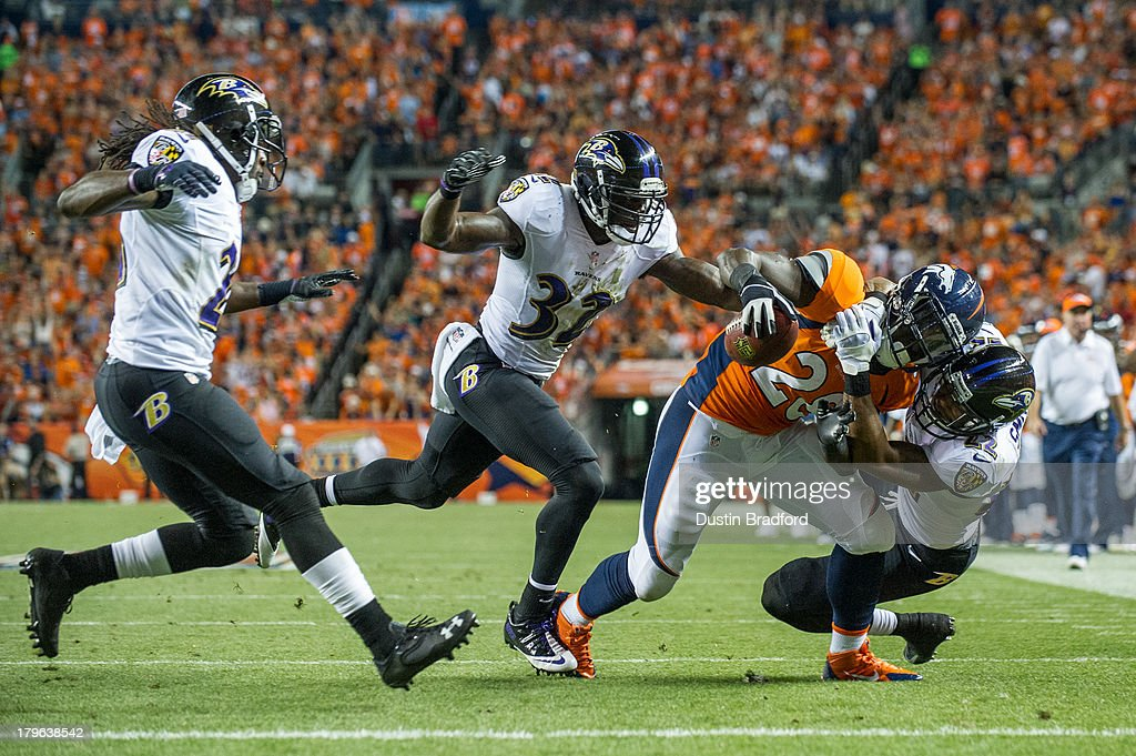 Running back <a gi-track='captionPersonalityLinkClicked' href=/galleries/search?phrase=Montee+Ball&family=editorial&specificpeople=6475135 ng-click='$event.stopPropagation()'>Montee Ball</a> #28 of the Denver Broncos is tackled by cornerback Jimmy Smith #22 of the Baltimore Ravens inside the two yard line during the game at Sports Authority Field at Mile High on September 5, 2013 in Denver Colorado.