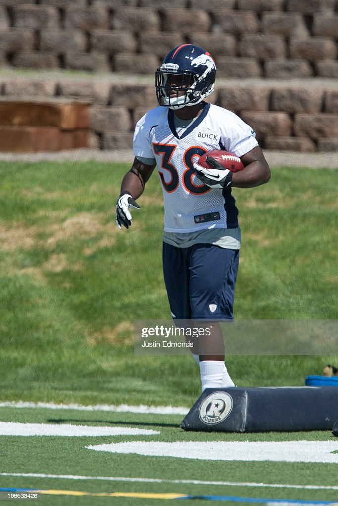 Running back <a gi-track='captionPersonalityLinkClicked' href=/galleries/search?phrase=Montee+Ball&family=editorial&specificpeople=6475135 ng-click='$event.stopPropagation()'>Montee Ball</a> #38 of the Denver Broncos participates in rookie camp at Dove Valley on May 10, 2013 in Englewood, Colorado.