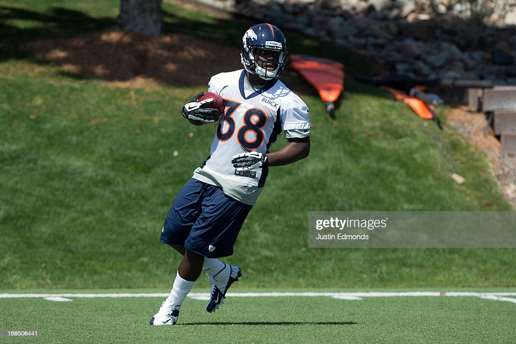 Running back <a gi-track='captionPersonalityLinkClicked' href=/galleries/search?phrase=Montee+Ball&family=editorial&specificpeople=6475135 ng-click='$event.stopPropagation()'>Montee Ball</a> #38 of the Denver Broncos runs with the ball during rookie camp at Dove Valley on May 10, 2013 in Englewood, Colorado.
