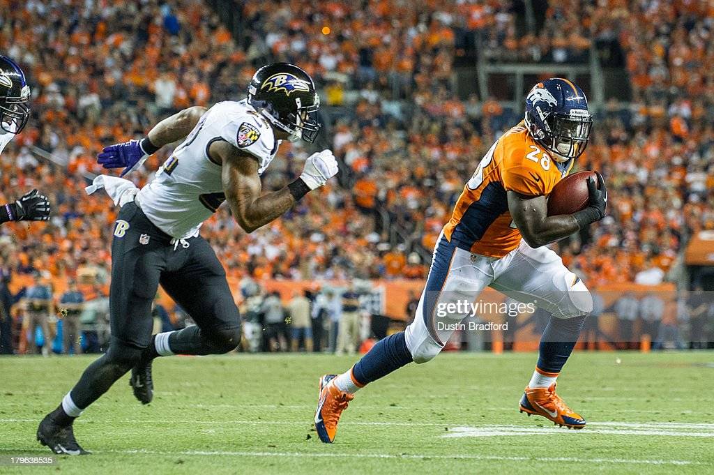 Running back <a gi-track='captionPersonalityLinkClicked' href=/galleries/search?phrase=Montee+Ball&family=editorial&specificpeople=6475135 ng-click='$event.stopPropagation()'>Montee Ball</a> #28 of the Denver Broncos rushes under coverage by cornerback Jimmy Smith #22 of Baltimore Ravens during the game at Sports Authority Field at Mile High on September 5, 2013 in Denver Colorado.
