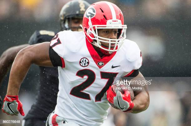 Running back Nick Chubb of the Georgia Bulldogs carries the ball during a game against the Vanderbilt Commodores at Vanderbilt Stadium on October 7...