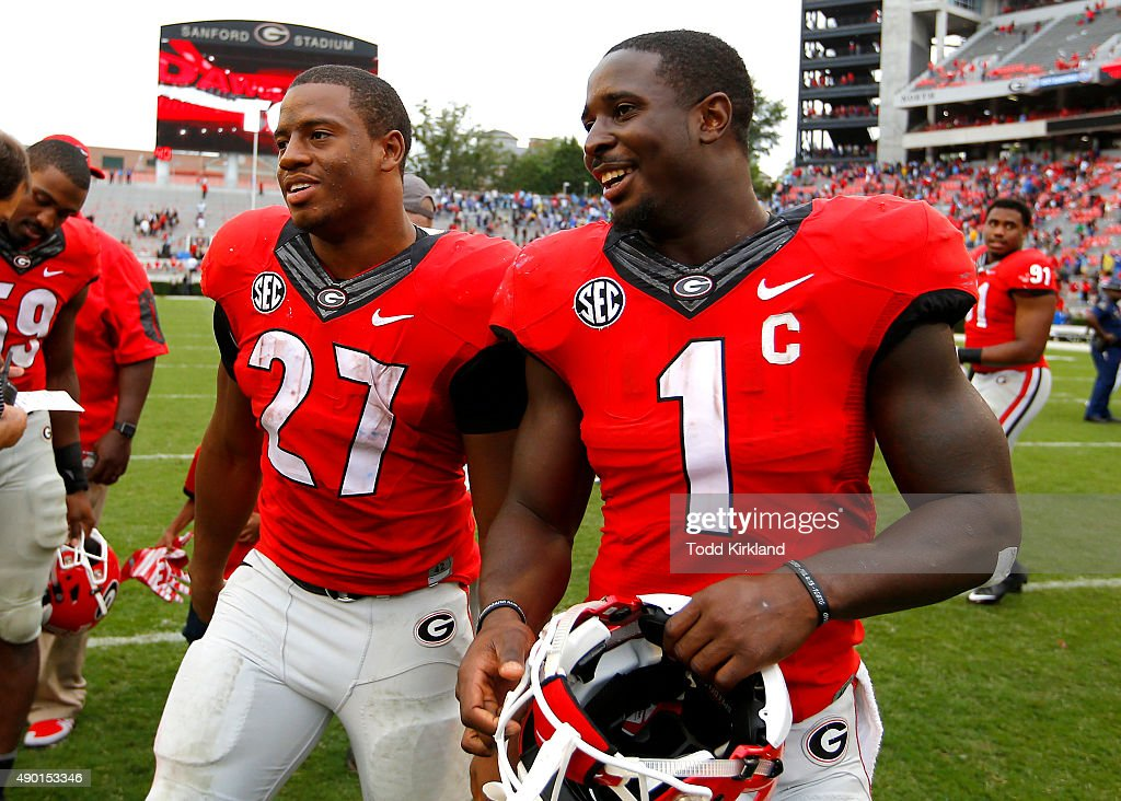 Running back Nick Chubb of the Georgia Bulldogs celebrates with running back Sony Michel at the conclusion of the game against the Southern...