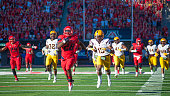 Running back Nick Wilson of the Arizona Wildcats returns a kickoff for a 72 yard touchdown against the Arizona State Sun Devils at Arizona Stadium on...