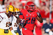 Running back Nick Wilson of the Arizona Wildcats runs to score a 72 yard rushing touchdown in the third quarter during the Territorial Cup college...