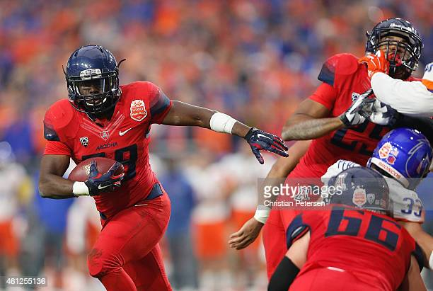 Running back Nick Wilson of the Arizona Wildcats rushes the football against the Boise State Broncos during the Vizio Fiesta Bowl at University of...