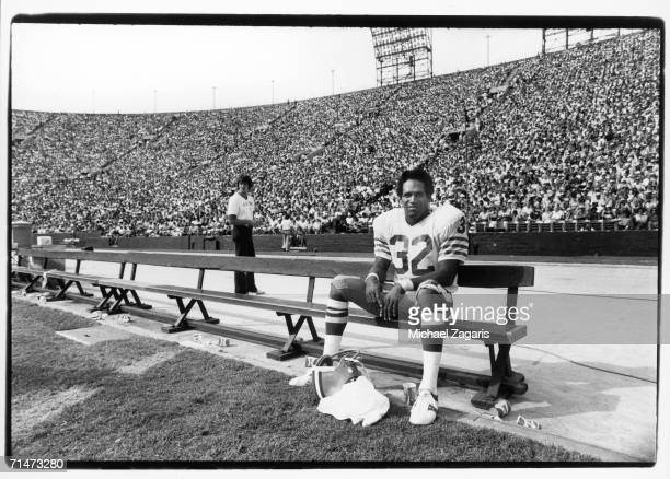 Running back OJ Simpson of the San Francisco 49ers sits on the bench during the game against the Los Angeles Rams at the Los Angeles Memorial...