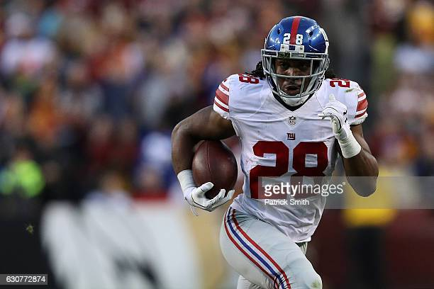 Running back Paul Perkins of the New York Giants carries the ball against the Washington Redskins in the first quarter at FedExField on January 1...