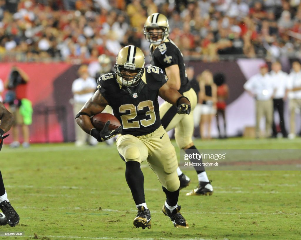 Running back <a gi-track='captionPersonalityLinkClicked' href=/galleries/search?phrase=Pierre+Thomas&family=editorial&specificpeople=937507 ng-click='$event.stopPropagation()'>Pierre Thomas</a> #23 of the New Orleans Saints rushes upfield in the 4th quarter against the Tampa Bay Buccaneers September 15, 2013 at Raymond James Stadium in Tampa, Florida.