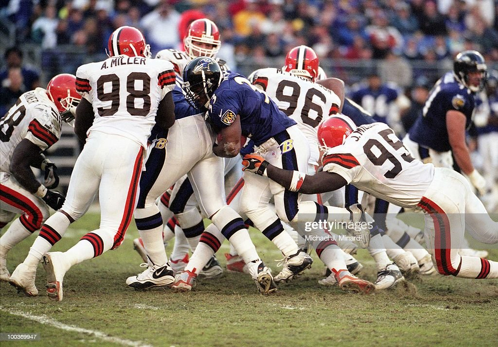 Running Back Priest Holmes #33 of the Baltimore Ravens gains a few yards before being tackled by Jamir Miller #95 of the Cleveland Browns in a NFL game at PSINet Ravens Stadium on November 26, 2000 in Baltimore, Maryland. The Ravens won 44 to 7.