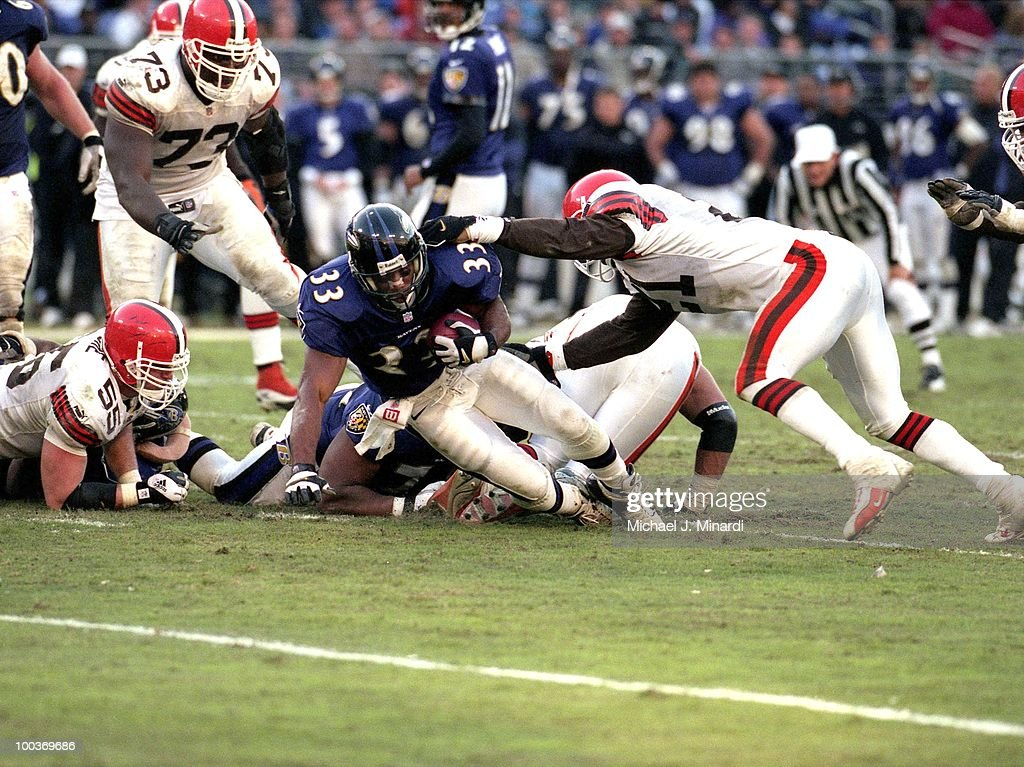 Running Back Priest Holmes #33 of the Baltimore Ravens makes some yardage bfore being brought down by Defensive Back Marquis Smith #21 of the Cleveland Browns during a NFL game at PSINet Stadium on November 26, 2000 in Baltimore, Maryland. The Ravens won 44 to 7.