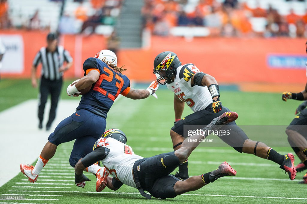Running back Prince-Tyson Gulley #23 of the Syracuse Orange is forced down by linebacker Jalen Brooks #43 of the Maryland Terrapins during the first quarter on September 20, 2014 at The Carrier Dome in Syracuse, New York. Maryland defeats Syracuse 34-20.