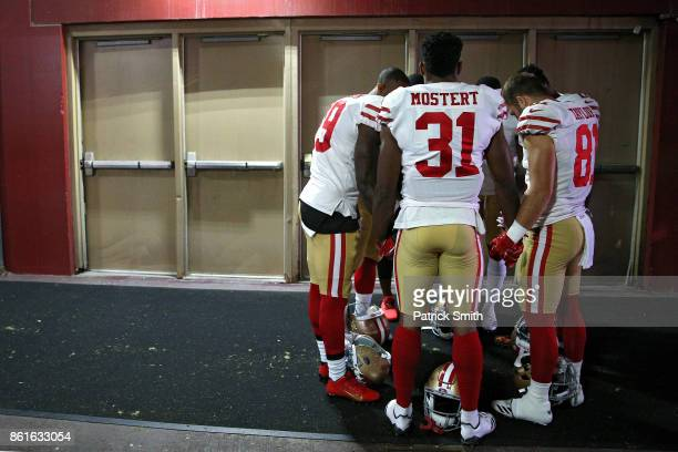 Running back Raheem Mostert of the San Francisco 49ers joins hands with teammates in the tunnel during pregame before playing against the Washington...