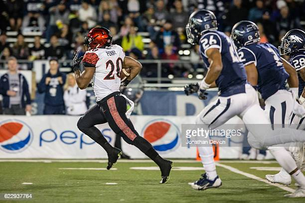 Running back Rashaad Penny of San Diego outruns Nevada players for a touchdown at Mackay Stadium on November 12 2016 in Reno Nevada
