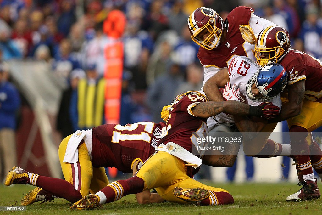 Running back Rashad Jennings of the New York Giants rushes against inside linebacker Perry Riley of the Washington Redskins in the third quarter at...