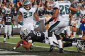 Running back Rashad Jennings of the Oakland Raiders scores a touchdown on an eightyard run against the Philadelphia Eagles in the second quarter on...