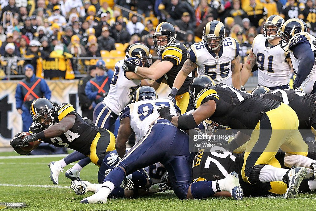 Running back Rashard Mendenhall #34 of the Pittsburgh Steelers rushes for a touchdown against the St. Louis Rams during the game at Heinz Field on December 24, 2011 in Pittsburgh, Pennsylvania.