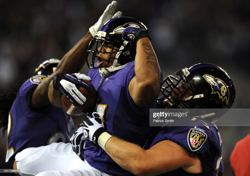 Running back <a gi-track='captionPersonalityLinkClicked' href=/galleries/search?phrase=Ray+Rice&family=editorial&specificpeople=3980395 ng-click='$event.stopPropagation()'>Ray Rice</a> #27 of the Baltimore Ravens celebrates his seven-yard touchdown run against the Cincinnati Bengals in the first half at M&T Bank Stadium on September 10, 2012 in Baltimore, Maryland.