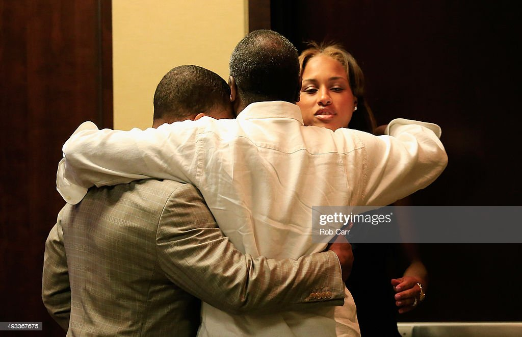 Running back <a gi-track='captionPersonalityLinkClicked' href=/galleries/search?phrase=Ray+Rice&family=editorial&specificpeople=3980395 ng-click='$event.stopPropagation()'>Ray Rice</a> of the Baltimore Ravens gets a hug from his wife Janay and father in law Joe Palmer following a news conference at the Ravens training center on May 23, 2014 in Owings Mills, Maryland. Rice spoke publicly for the first time since facing felony assault charges stemming from a February incident involving Janay at an Atlantic City casino.