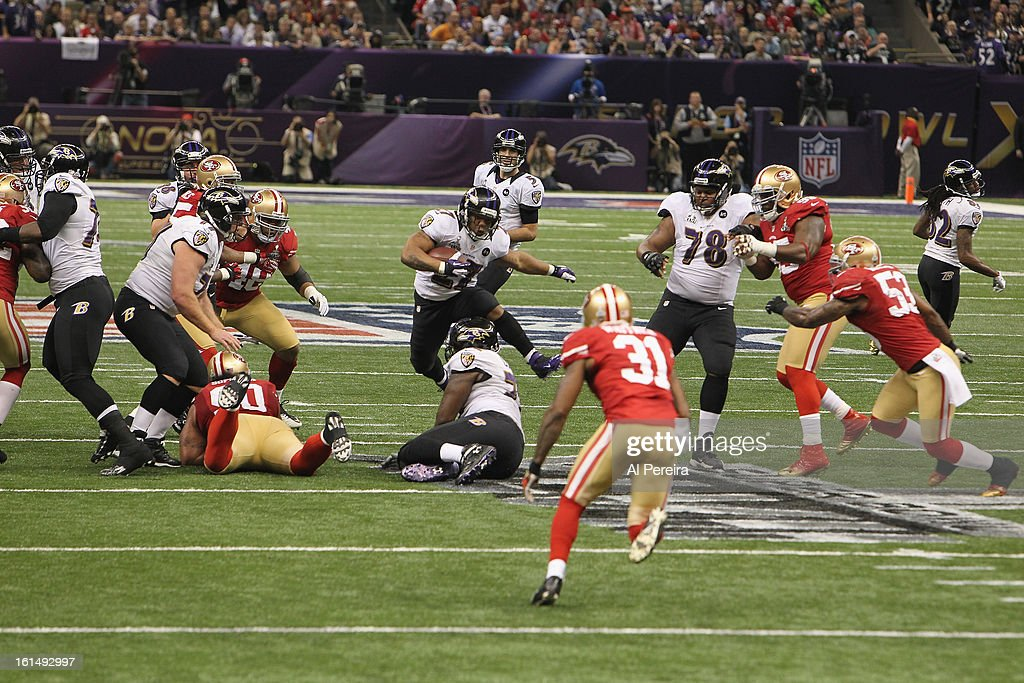 Running Back Ray Rice #27 of the Baltimore Ravens has a long gain against the San Francisco 49ers during Super Bowl XLVII at Mercedes-Benz Superdome on February 3, 2013 in New Orleans, Louisiana.