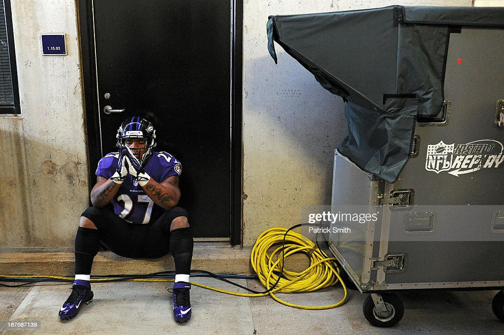 Running back <a gi-track='captionPersonalityLinkClicked' href=/galleries/search?phrase=Ray+Rice&family=editorial&specificpeople=3980395 ng-click='$event.stopPropagation()'>Ray Rice</a> #27 of the Baltimore Ravens has a moment to himself before playing the Cincinnati Bengals at M&T Bank Stadium on November 10, 2013 in Baltimore, Maryland.