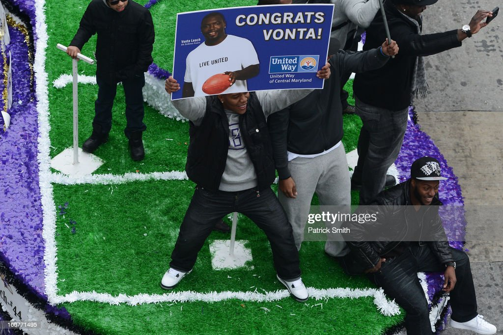 Running back Ray Rice #27 of the Baltimore Ravens holds up a sign as he and teammates celebrate during their Super Bowl XLVII victory parade near M&T Bank Stadium on February 5, 2013 in Baltimore, Maryland. The Baltimore Ravens captured their second Super Bowl title by defeating the San Francisco 49ers.
