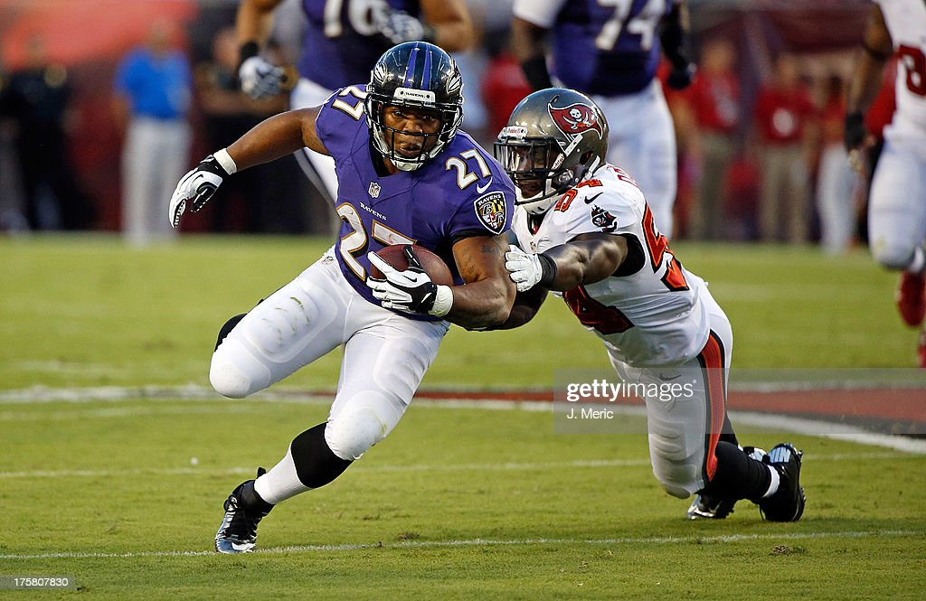 Running back <a gi-track='captionPersonalityLinkClicked' href=/galleries/search?phrase=Ray+Rice&family=editorial&specificpeople=3980395 ng-click='$event.stopPropagation()'>Ray Rice</a> #27 of the Baltimore Ravens is tackled by linebacker Lavonte David #54 of the Tampa Bay Buccaneers during a preseason game at Raymond James Stadium on August 8, 2013 in Tampa, Florida.