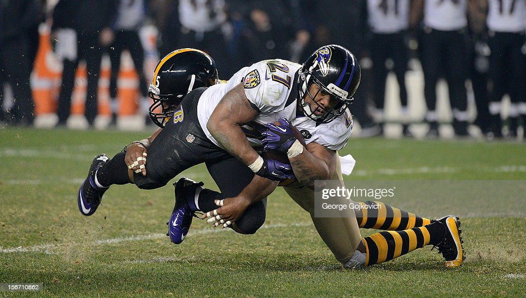 Running back Ray Rice #27 of the Baltimore Ravens is tackled by safety Ryan Clark #25 of the Pittsburgh Steelers during a game at Heinz Field on November 18, 2012 in Pittsburgh, Pennsylvania. The Ravens defeated the Steelers 13-10. The Steelers wore throwback uniforms based on the uniform worn by the Steelers in 1934.