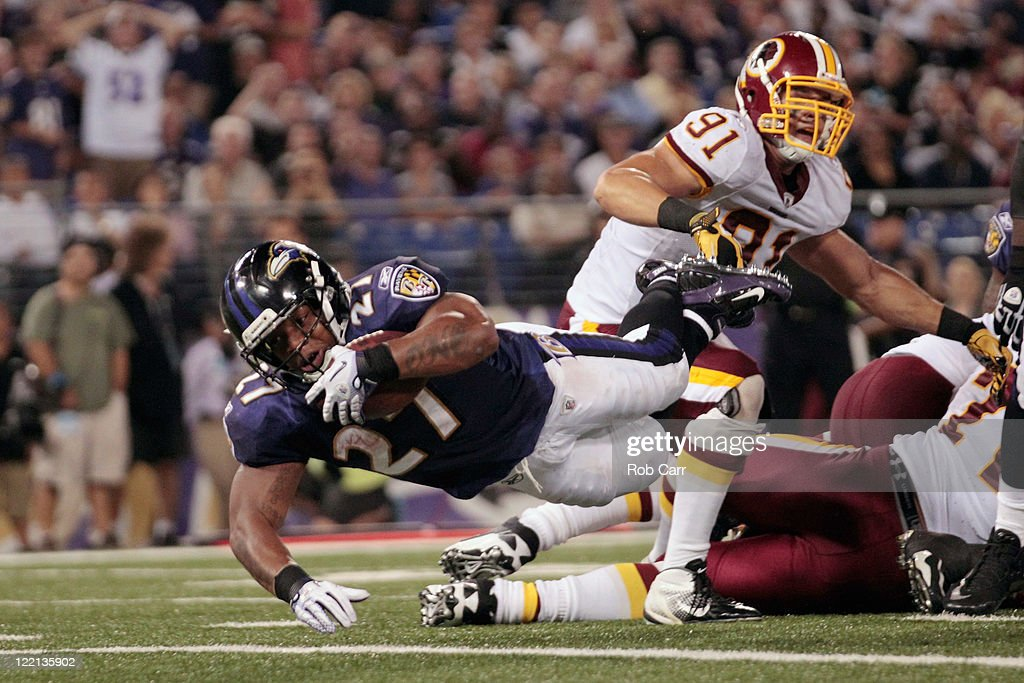 Running back <a gi-track='captionPersonalityLinkClicked' href=/galleries/search?phrase=Ray+Rice&family=editorial&specificpeople=3980395 ng-click='$event.stopPropagation()'>Ray Rice</a> #27 of the Baltimore Ravens leaps into the end zone for a touchdown in front of <a gi-track='captionPersonalityLinkClicked' href=/galleries/search?phrase=Ryan+Kerrigan&family=editorial&specificpeople=4671640 ng-click='$event.stopPropagation()'>Ryan Kerrigan</a> #91 of the Washington Redskins during the first half of a preseason game at M&T Bank Stadium on August 25, 2011 in Baltimore, Maryland.