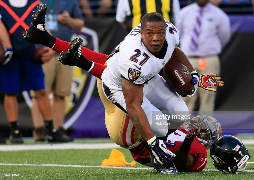 Running back <a gi-track='captionPersonalityLinkClicked' href=/galleries/search?phrase=Ray+Rice&family=editorial&specificpeople=3980395 ng-click='$event.stopPropagation()'>Ray Rice</a> #27 of the Baltimore Ravens looses his helmet after being tackled by strong safety <a gi-track='captionPersonalityLinkClicked' href=/galleries/search?phrase=Antoine+Bethea&family=editorial&specificpeople=2535027 ng-click='$event.stopPropagation()'>Antoine Bethea</a> #24 of the San Francisco 49ers during the first half of an NFL pre-season game at M&T Bank Stadium on August 7, 2014 in Baltimore, Maryland.