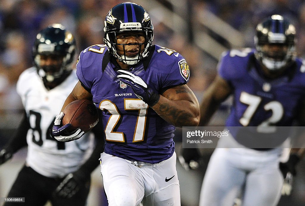 Running back <a gi-track='captionPersonalityLinkClicked' href=/galleries/search?phrase=Ray+Rice&family=editorial&specificpeople=3980395 ng-click='$event.stopPropagation()'>Ray Rice</a> #27 of the Baltimore Ravens runs for a first down against the Jacksonville Jaguars in the first quarter at M&T Bank Stadium on August 23, 2012 in Baltimore, Maryland.