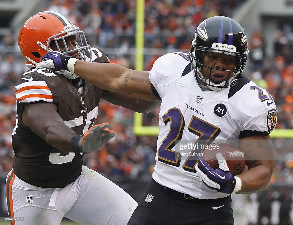 Running back <a gi-track='captionPersonalityLinkClicked' href=/galleries/search?phrase=Ray+Rice&family=editorial&specificpeople=3980395 ng-click='$event.stopPropagation()'>Ray Rice</a> #27 of the Baltimore Ravens runs the ball by linebacker James-Michael Johnson #50 of the Cleveland Browns at Cleveland Browns Stadium on November 4, 2012 in Cleveland, Ohio.