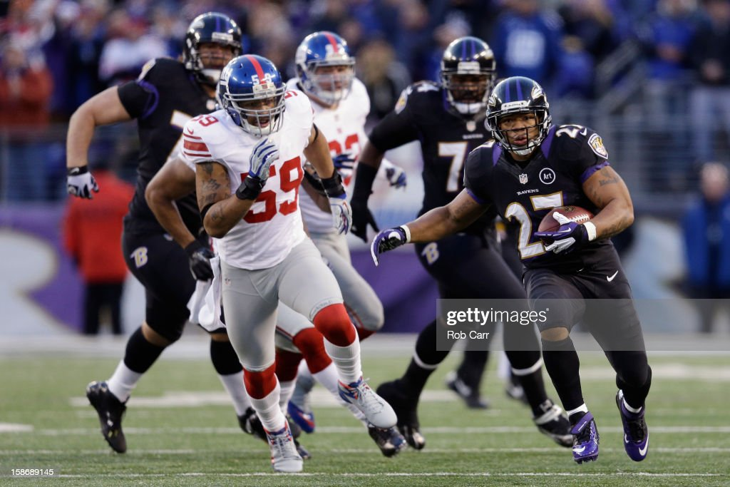 Running back <a gi-track='captionPersonalityLinkClicked' href=/galleries/search?phrase=Ray+Rice&family=editorial&specificpeople=3980395 ng-click='$event.stopPropagation()'>Ray Rice</a> #27 of the Baltimore Ravens rushes the ball against the New York Giants during the first half at M&T Bank Stadium on December 23, 2012 in Baltimore, Maryland.