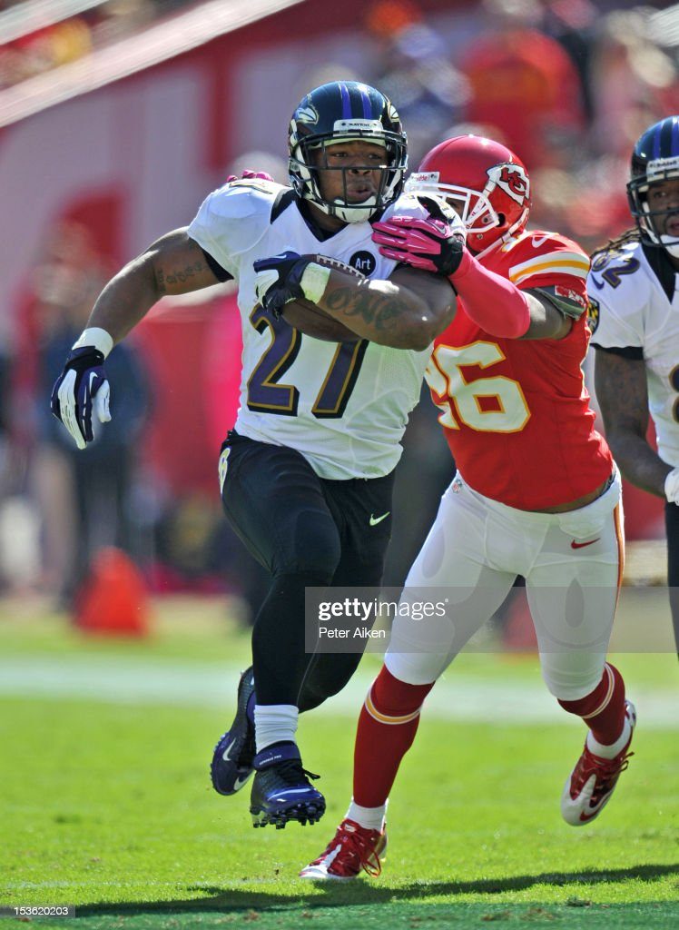 Running back <a gi-track='captionPersonalityLinkClicked' href=/galleries/search?phrase=Ray+Rice&family=editorial&specificpeople=3980395 ng-click='$event.stopPropagation()'>Ray Rice</a> #27 of the Baltimore Ravens rushes up field past defensive back Stanford Routt of the Kansas City Chiefs during the first quarter on October 7, 2012 at Arrowhead Stadium in Kansas City, Missouri.