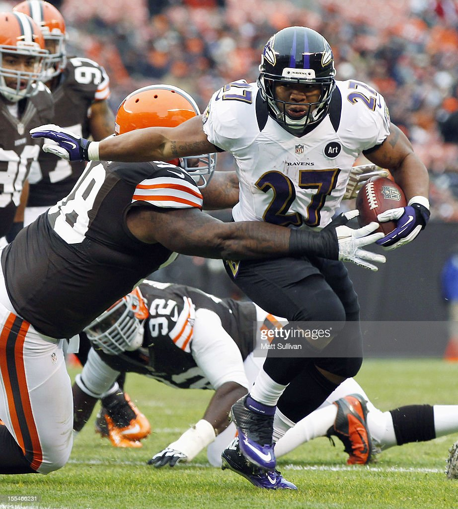 Running back <a gi-track='captionPersonalityLinkClicked' href=/galleries/search?phrase=Ray+Rice&family=editorial&specificpeople=3980395 ng-click='$event.stopPropagation()'>Ray Rice</a> #27 of the Baltimore Ravens scores a touchdown as he runs through the Cleveland Browns defense at Cleveland Browns Stadium on November 4, 2012 in Cleveland, Ohio.