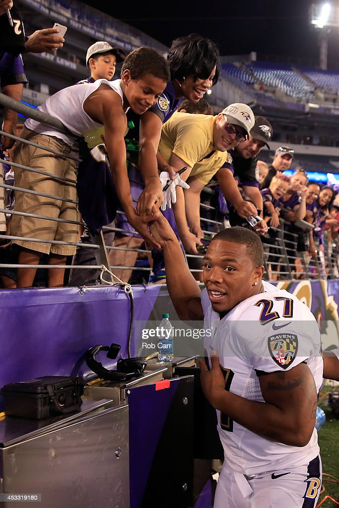 Running back Ray Rice #27 of the Baltimore Ravens shakes hands with fans following the Ravens 23-3 win over the San Francisco 49ers during NFL pre-season game at M&T Bank Stadium on August 7, 2014 in Baltimore, Maryland.