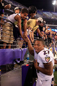 Running back Ray Rice of the Baltimore Ravens shakes hands with fans following the Ravens 233 win over the San Francisco 49ers during NFL preseason...