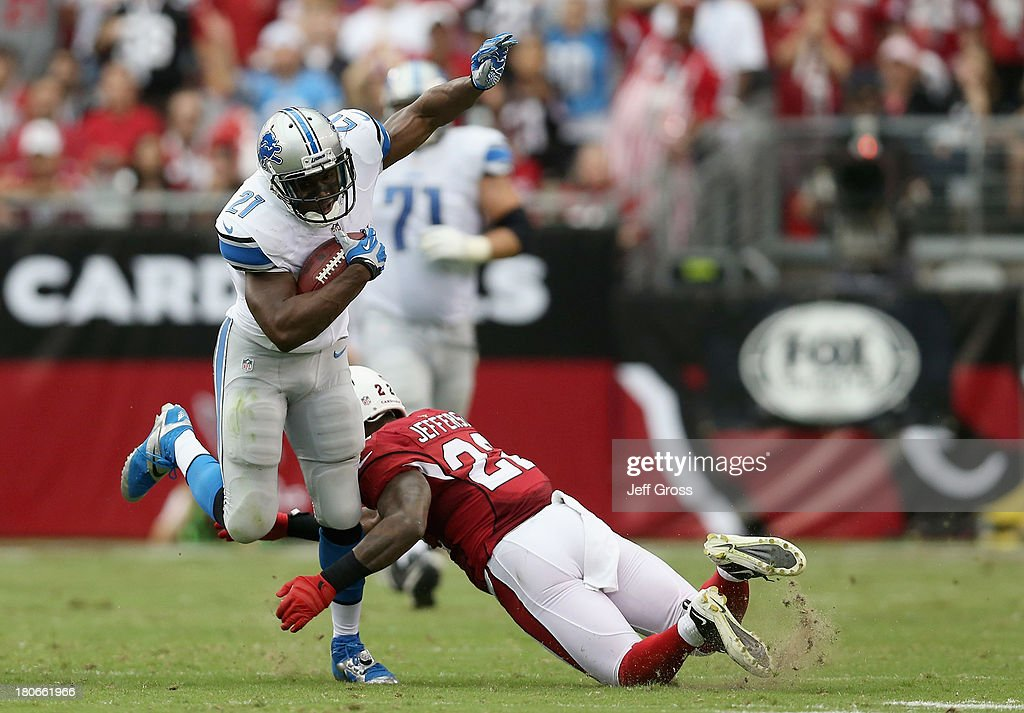 Running back <a gi-track='captionPersonalityLinkClicked' href=/galleries/search?phrase=Reggie+Bush&family=editorial&specificpeople=183392 ng-click='$event.stopPropagation()'>Reggie Bush</a> #21 of the Detroit Lions is tackled by defensive back Tony Jefferson #22 of the Arizona Cardinals in the second quarter at University of Phoenix Stadium on September 15, 2013 in Glendale, Arizona. The Cardinals defeated the Lions 25-21.
