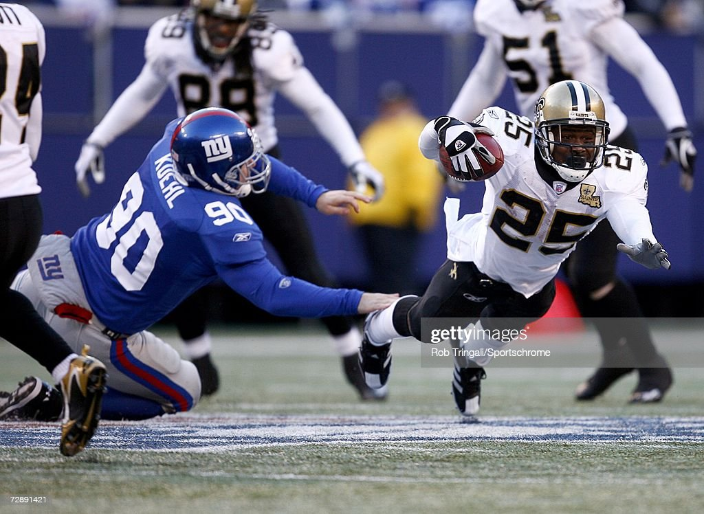 http://media.gettyimages.com/photos/running-back-reggie-bush-of-the-new-orleans-saints-runs-with-the-ball-picture-id72891421
