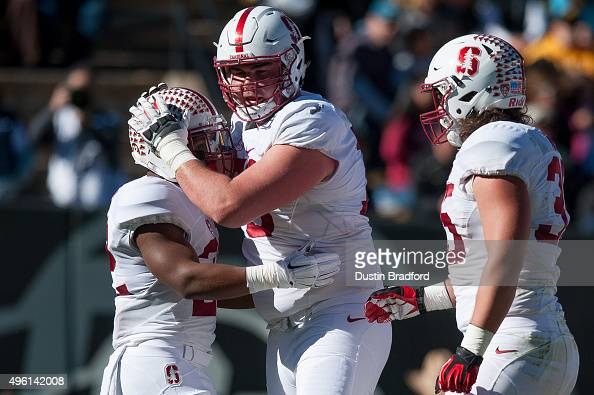 Running back Remound Wright of the Stanford Cardinal celebrates with offensive tackle Kyle Murphy and fullback Daniel Marx after scoring a touchdown...