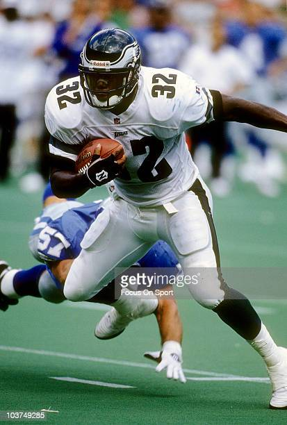Running Back Ricky Watters of the Philadelphia Eagles carries the ball against the Detroit Lions during an NFL football game September 3 1996 at...