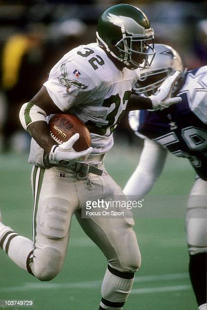 Running Back Ricky Watters of the Philadelphia Eagles carries the ball against the Dallas Cowboys during an NFL football game December 10 1995 at...