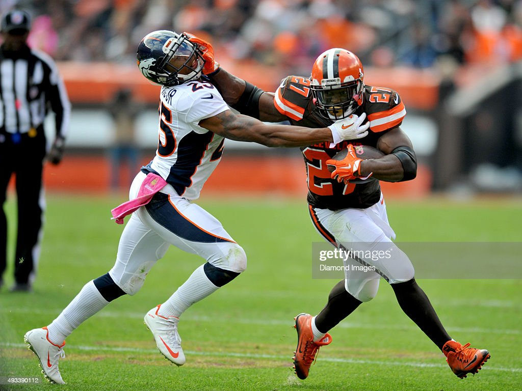 Running back <a gi-track='captionPersonalityLinkClicked' href=/galleries/search?phrase=Robert+Turbin&family=editorial&specificpeople=5597853 ng-click='$event.stopPropagation()'>Robert Turbin</a> #27 of the Cleveland Browns stiff arms cornerback <a gi-track='captionPersonalityLinkClicked' href=/galleries/search?phrase=Chris+Harris+-+American+Football+Cornerback&family=editorial&specificpeople=15029474 ng-click='$event.stopPropagation()'>Chris Harris</a> #25 of the Denver Broncos during a game on October 18, 2015 at FirstEnergy Stadium in Cleveland, Ohio. Denver won 26-23 in overtime.