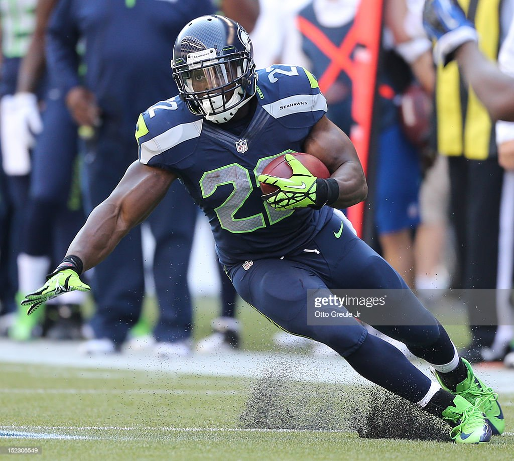 Running back Robert Turbin #22 of the Seattle Seahawks rushes against the Dallas Cowboys at CenturyLink Field on September 16, 2012 in Seattle, Washington.